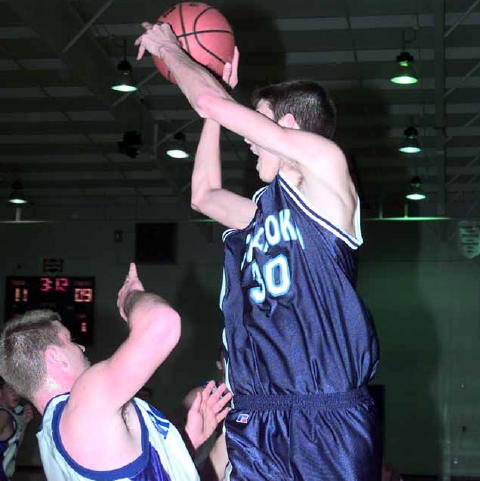 Culleoka- Casey Holt (29 points) goes up over Michael Byrd- Chapel Hill