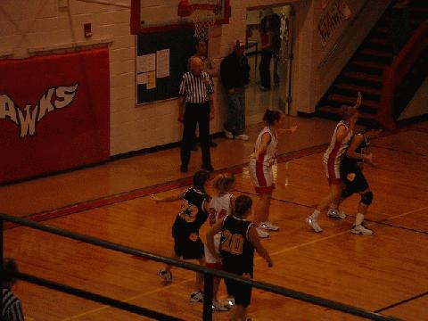 #20 Deltedesco breaking to the middle, while #44 Allen, #23 Boyd post up
