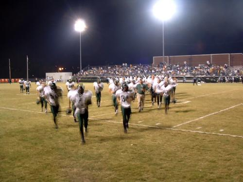 Hornets racing off the field for Halftime, down 7-14