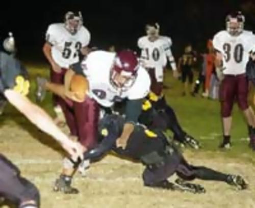 Warrior running back Michael Hollifeld plows ahead in theChuckey-Doak game.  --- photo by Elizabethton Star - Dave Boyd