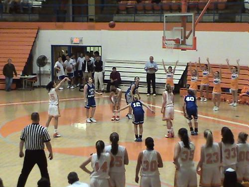 LADY  COUGAR'S #15 SARAH MUNAL SHOOTS FREE THROWS IN THE FINAL SECONDS OF THE GAME...