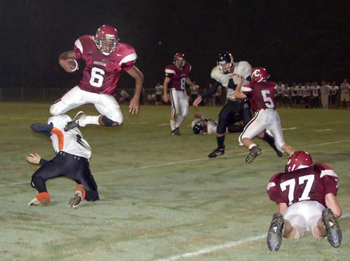 Cheatham running back Michael Johnson (6) leaps over a Richland defender for one of  his two touchdown runs.