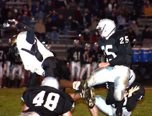 Millington's Gary Askew leaps to block Mustangs kicker Zach Miller attempt.