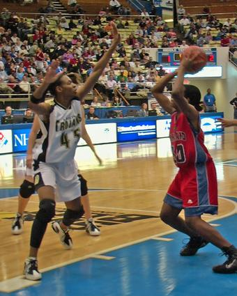 Dyersburg's Latroya Mitchell goes for the block.