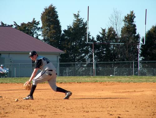Panthers 2nd baseman Tyler Cosby goes after ground ball in  12-10 win  over South Green