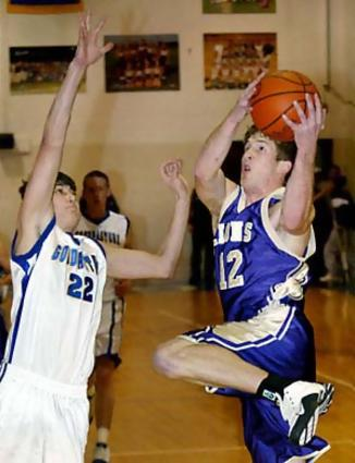CPA's Travis Sikes, right, goes to the hoop past Goodpasture's Chris Buchanan during the first half in Madison, Tenn., Friday, Jan. 14, 2005.