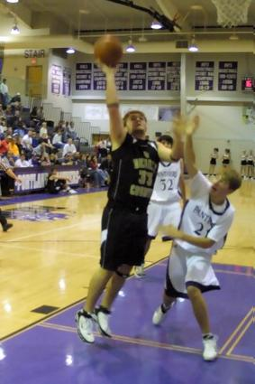 Jake Nokes lays it up for two during DeKalb County's victory over Portland.