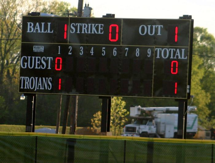 Millington scores the first run on its brand new scoreboard in the first.