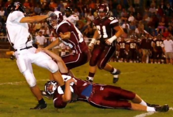 Tennessee High's Matt Fleenor (22) has a lock on Elizabethton's Derek Carr (21) legs to stop a screen play from becoming a major gain. The Viking's Alan Hull (83) gets in on the tackle.