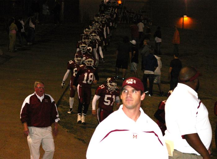 Prior to kickoff, Wayne Randall leads the Region 7-4A Champions onto the field.