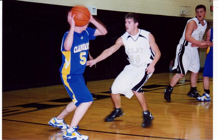 Clay County's Scott Brown guards Clarkrange's Josh Duvall