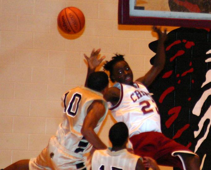 Trojan Trey Woods fouls White during the second quarter.
