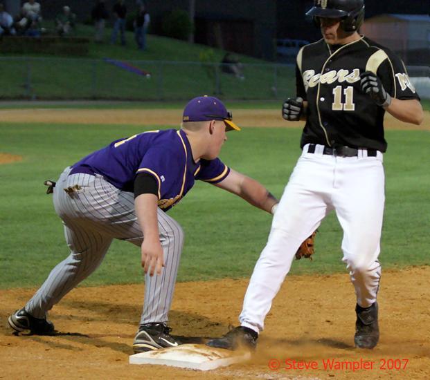 Mt. Juliet's Ryan Overstreet beats the throw to Smyrna's First Baseman, Austin Townes